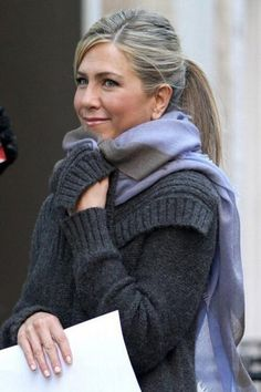 Jennifer Aniston Wanderlust 2010 ... With her ashy hair pulled back, we see how the soft plummy-rose of her blush and lips works so well with the soft blue-violet and heather grey she is wearing. Too often, her hair has too much tawny warmth, which brings her down.