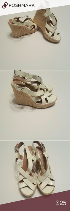 Vince Camuto Sandals Size 6.5 Vince Camuto Sandals  In good condition. 2 spots on straps shown in 4th picture.  Cream color upper tan wedge. Vince Camuto Shoes Sandals