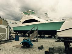 This is a finished paint job. I've done a couple of yacht redesigns with my signature color palette for hull and interior items. Yacht Interior, Social Media Banner, Photography Services, Catamaran, Web Development, Palm Beach, Exterior Design, Signage, Boats