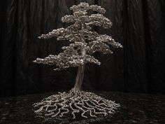 Kevin Iris creates these incredibly detailed tree sculptures from aluminum wire