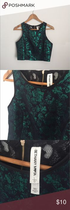 NWOT Emerald Lace Crop Top This crop top is to die for! It's NWOT so it's in perfect condition. Does not have stretch and has a zipper on the back. Aeropostale Tops Crop Tops