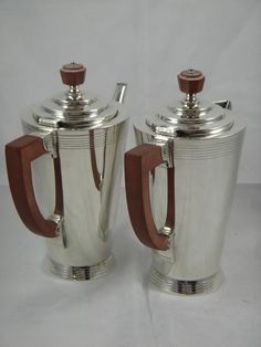 The same design coffee and hot water jug but in silver plate. Marked with the Rd. No. 772181 and W27683. Maybe the different coloured attachments warrent a different Rd. No.