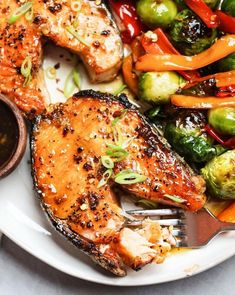 Garlicky Miso Glazed Salmon Steaks Easy Weeknight Dinners, Quick Meals, Healthy Dinners, Salmon Steak Recipes, Maple Glazed Salmon, Garlic Salmon, Sauteed Vegetables, Grass Fed Butter, Salmon Fillets