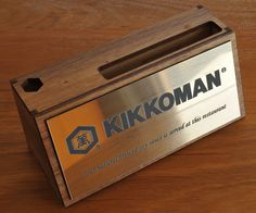 Desk Sign. Laser cut walnut timber base with business card and pen holder. Face  in Brush gold metallic acrylic 65 x 150 mm laser engraved black image and text. MyChoice@Firebridge