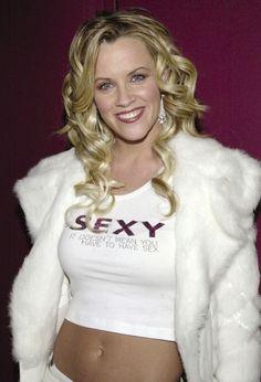 alyssa milano unbuttoning her blouse nude