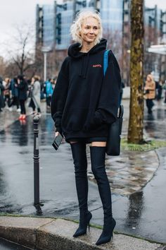 Over the knee boots + casual sweatshirt. Paris fashion week street style.