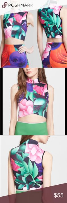 Clover Canyon Lotus Garden Neoprene Crop Top SZ Sm Sold out in almost all stores, this svelte neoprene crop top zips to a conservative stand-up collar while defying mid-century modesty with a very modern cropped silhouette. A deliciously over saturated lotus blossom print calls to mind the visual stimulation of a whirlwind trip through Asia. Hidden front zipper. 90% Polyester 10% Spandex. Size Small Clover Canyon Tops Crop Tops