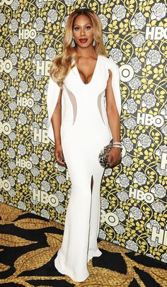 Laverne Cox wore an ivory cape gown featuring flattering mesh panelling on the obliques and a center slit. She completed the outfit with a prismatic clutch and sparkly baubles. See more Golden Globes afterparty looks here!