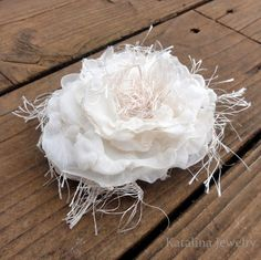 How to make this fabric flower... sheer voile (melted on edges, and a bit thru centers for texture), eyelash yarn. She stapled, but can also sew it. Katalina Jewelry: Downton Abbey style hat in 20 minutes!