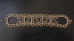 Detailed ( With Some Aid Of Wig Jig) Quirky Curly Copper Bracelet! $15