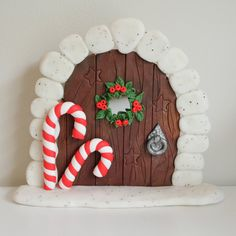 Christmas Fairy Door with Red and White Candy Canes, Berry Wreath around a Tiny Mirror and Wood Effect Door. Handmade using Polymer Clay by FairyFantasticClay on Etsy Woodland Christmas, Christmas Fairy, Christmas Door, Christmas Crafts, Christmas Ornaments, Clay Projects, Clay Crafts, Winter Fairy, Polymer Clay Christmas