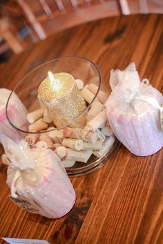 DIY Bridal Shower table centerpiece with wine corks and gold glitter candle. Mini wine glass favors. Wine themed Bridal Shower at a winery.