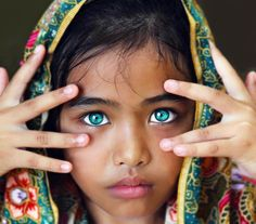 I think it's the most extraordinary thing to have dark skin and bright blue eyes xx its beautifully exraordinary