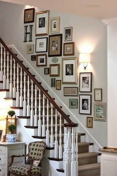 The unusual shapes and angles of stairway walls allow you to create dynamic wall groupings. In addition to the family photos shown here, art...
