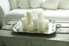 Simple silver tray.  Simple white pillar candles.  Simple beauty.  Did I say simple?