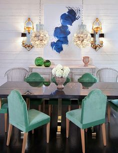 Colors in bedroom  Like the textured white walls...graphic INK BLUE art, AQUA velvet chrs, and EMERALD GREEn glass...cool mix of lighting fixtures too!!