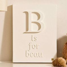 This would be a cute idea to use a small canvas and make an alphabet wall