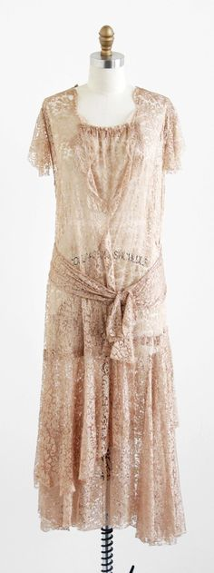Dress: ca. 1920's, custom made silk lace, gathered neckline, attached sash, drop waist, partly open wrap construction.