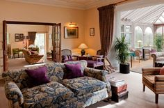 Linthwaite House - We encourage our guests to put their feet up in front of our cosy fire.