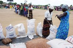 Internally displaced people line up to receive food provided by the World Food Programme on June 15, 2006, at the Pabbo camp outside Gulu, northern Uganda.