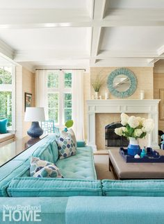 These designer coastal living rooms have all one thing in common. A great blue sofa! From light blue to turquoise to navy blue. You sofa does not have to be white, beige, or gray. Featured on completely-coastal.com
