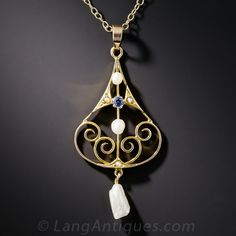 Art Nouveau Sapphire and Pearl Pendant. Lovely American gems adorn this hand-fabricated sapphire and freshwater pearl necklace. Delicate waves of gold support small freshwater pearls punctuated with a .08 carat blue sapphire from Montana, with a 'tooth' pearl from the Mississippi River delicately dangling. Created in 14 karat yellow gold and suspended on a 16 1/2 inch cable chain. A treasure mom could wear every day.