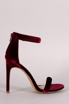 Description This chic heel features a soft velvet upper, one band across vamp, ankle strap with partial elastic insert, and wrapped stiletto heel. Finished with a lightly cushioned insole and rear zip