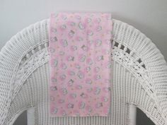 Adorable baby blanket: The baby pink background of this blanket is decorated with fluffy little sheep jumping over a fence. Your own little