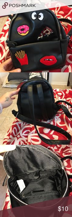 Small backpack from forever 21 Small black faux leather bag from forever 21. Has a few patches that came with the bag. Great condition! Perfect for theme parks  or just roaming around town :) Forever 21 Bags Backpacks