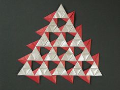 "Kraft-paper art made of Sierpinski Triangles, by Mélisande. ""Triangle quilt (opus XII)"""