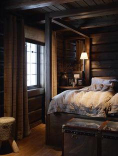 Dark wood, moody lighting, luxurious bedding, lots of texture. Feels like a cocoon and I want to crawl in