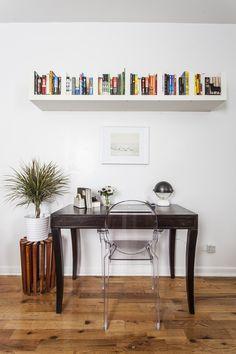 floating bookshelf over a simple desk