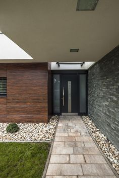 Home Decorations: Futuristic Alley Covered Aside Stone Tiles Along With Pebbles Detail On Both Sides To Connect Deck As Well As Main Home Entrance from Eclectic Residence Providing Refreshing Green Tinge Thoroughly