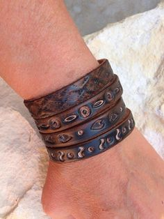 These thin leather bangles are custom made to fit you. These are riveted together.. Just slip them on. They look amazing layered with your other jewelry. For men or women. You will receive 2 bangles.
