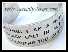 Stamped Warning Autism Mom Black Belt Strength Custom Silver Metal Cuff Bracelet. $16.95, via Etsy.