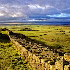 HADRIAN'S WALL : a defensive fortification begun in 122 AD, during the rule of Roman emperor Hadrian, to mark the northern border of the Roman Empire in Britain. It stretched across the width of Great Britain just south of the present day border with Scotland; it was the first of two fortifications built across Great Britain.