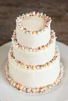 Mini cakes, white with sprinkles. Doing this with french vanilla or yellow cake with buttercream frosting and sprinkles for bros bday! But just one layer...  :)