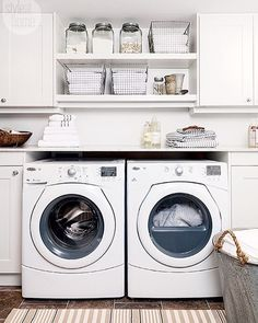 White laundry room with rustic storage details.