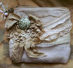 https://flic.kr/p/9V4rRK | attica | Zipper pouch made with vintage silks and lace.