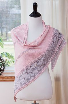 Inspired by the East Bank of the Flats in Cleveland, an area where man-made structure and the Cuyahoga River meet, this triangular shawl is knit from the top down using two colors. It features garter stripes with a section of gorgeous lace. The lace portion of the pattern is provided in both written and charted formats.