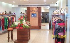 Retail Shop with hanging clothes - design by  Architect: Dhiraj Navani, India