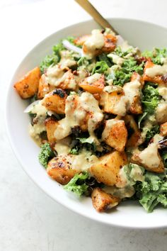 Spicy Potato Kale Bowls with Mustard Tahini Dressing - This Savory Vegan These Spicy Potato Kale Bowls with Mustard Tahini Dressing are the perfect Fall meal. Crispy potatoes, red onion, marinated kale and a delicious creamy dressing. Simple and healthy. Veggie Recipes, Fall Recipes, Whole Food Recipes, Vegetarian Recipes, Cooking Recipes, Healthy Recipes, Potato Recipes, Cooking Icon, Dinner Recipes