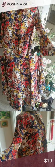 """UMGEE BOHO FLORAL LOOSE FLOWY BELL SLEEVE Boho Gypsy Floral Loose Flowy Bell Sleeves Dress Tunic size Small-Medium.  This is a beautiful UMGEE Swing Dress. Loose flowy fit, oversized and relaxed. Long bell sleeves. Woven cotton blend fabric. Feels like a beachy gauze fabric. Premium quality, pull over style. This dress slso looks great belted.  Small (2-4 & Medium 6-8) Bust measured laying flat 44"""". Waist and hips: Loose, total length 34""""  FREE GIFT INCLUDED UMGEE Dresses Asymmetrical"""