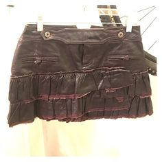Authentic leather ruffle mini skirt. Size 38 (2-4) Excellent condition, chocolate color.  Very unique.  Lined interior Skirts Mini
