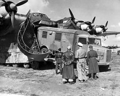 """Loading an Opel Blitz truck onto a German Messerschmitt Me-323 """"Gigant"""" transport plane. The Me-323 was the largest land-based transport aircraft of the war."""