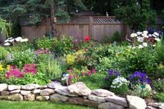 Small flower garden designs...I like the idea of less grass and more flowers