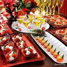 Host a gourmet tasting party. Put on a lavish Christmas tasting party with mini plates and bowls. Use festive red and white trays to display rows of mini bowls, tasting spoons and plates with petite servings of mini tartlets, ravioli or caprese salad. Mini creme de menthe martinis with a red sugar rim and a candy cane garnish make a festive addition.