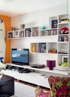 Boxy type shelves with the TV upon a cabinet
