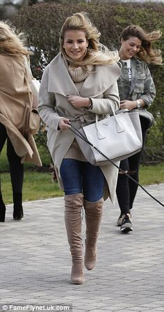 Dog walker chic: Georgia Kousoulou wrapped up in a cosy coat which she wore over skinny jeans and knee high boots
