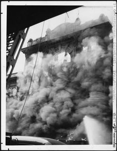 Smoke and flames masking Dunstable House, part of the department store of J Ballantynes and Company on Colombo Street, Christchurch, during the fir. Nz History, Christchurch New Zealand, City Library, State Of Arizona, South Pacific, Fire, Libraries, November, Random